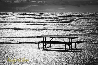 A picnic table deposited in the water off the beach at Presqu'ile Provincial Park south of Trenton, Ontario.