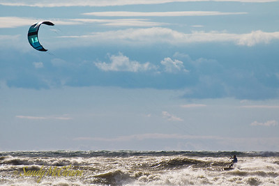 A kite surfer plies the waters off the beach at Presqu'ile Provincial Park south of Trenton, Ontario.