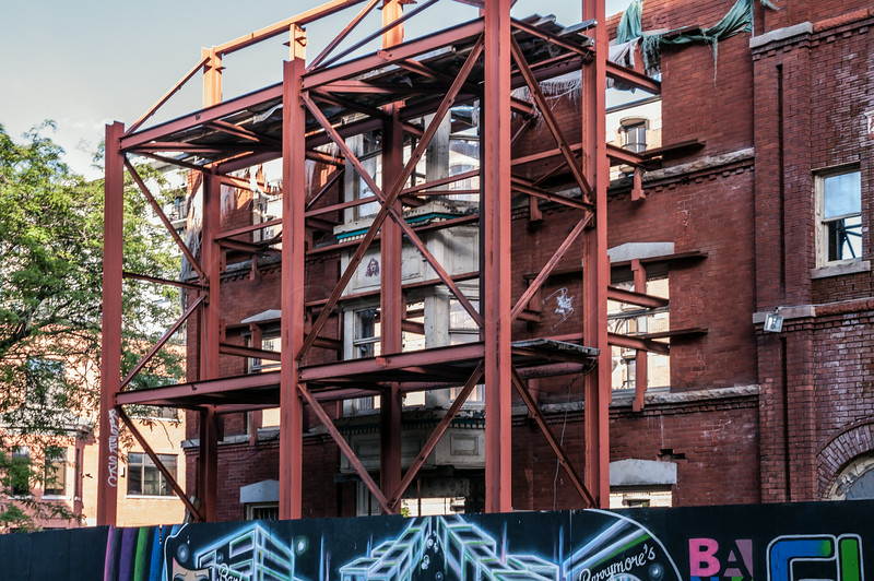 A facade being preserved while the building awaits to be erected behind.