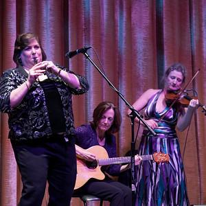 Joanie plays the tin whistle.