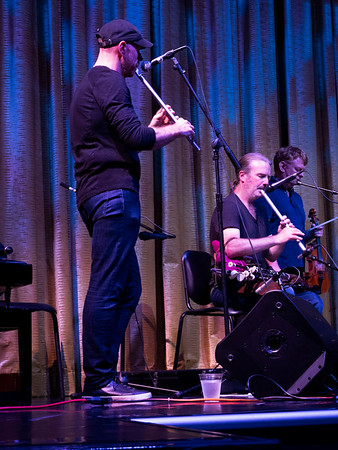 Kevin Crawford is the leader of Lunasa, He played the whistle and the bohdran, an Irish type of drum. Next to him, a very wonderful pipes player.