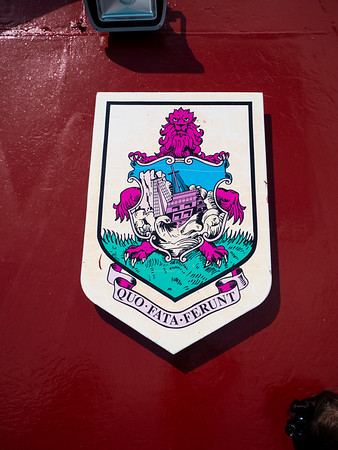 On the ferry, the coat of arms of Bermuda with its motto, Quo Fata Ferunt. Whither the Fates Carry Us. It refers to the establishment of the British presence in Bermuda (named for the Spaniard, Bermudez who had discoverd the isle a few years earlier but abandonded it as too small for habitation) when a ship was wrecked during a hurricane and the sailors took shelter on the island in 1609. For years it was politically administered as part of the British presence in Jamestown, Virginia.