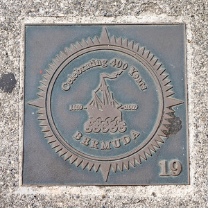 Plaque in the ground.