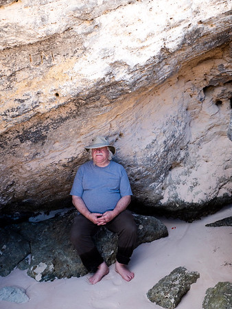 Mark found  shelter from the sun under a slab of cool rock.