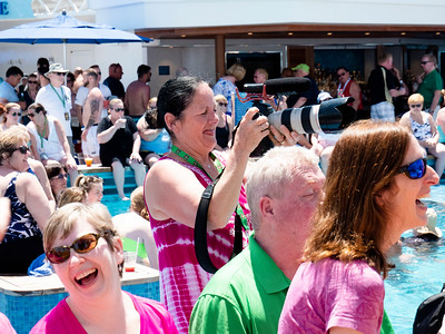 Maryann Mangan, working photographer, standing in the pool, who documented the entire Irish music cruise. Thank you!