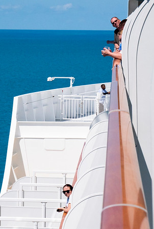 People are hanging out of their balconies to watch the ship's departure from Bermuda. Beyond, the vast Atlantic.