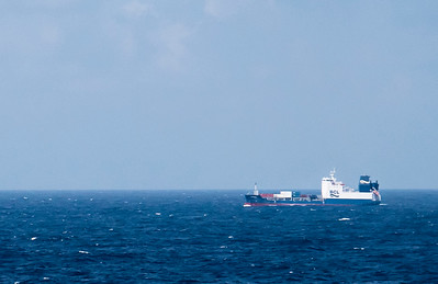 A close crop of the boat seen afar in the last photo shows BCL on its side: Bermuda Container Line. Aside for this ship, the ocean was devoid of any other human activity but for our ship.