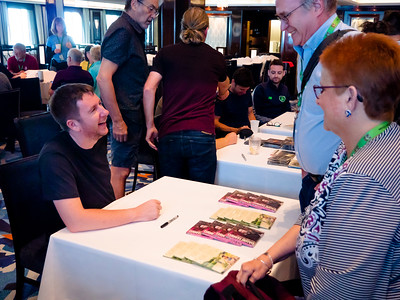 At the Meet 'N Greet on Saturday, our last day, Daoiri Farrell signs CD's for sale to his admirers.