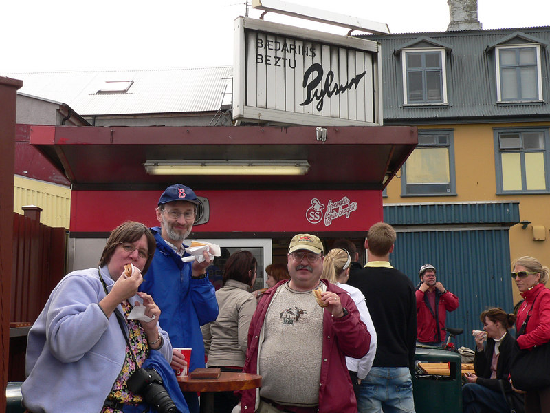 Hot dogs (pylsur) are a popular food in Iceland, go figure. There are Bev, Brian and Lee at a stand by the harbor, where Bill Clinton had a hot dog when he was in town.