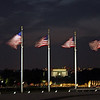 Flags around the Washington Monument fly in the breeze