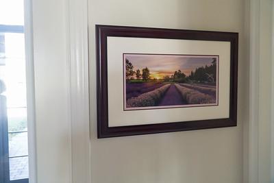 One of Dani's beautiful landscape photos hangs at the Welber's front door.