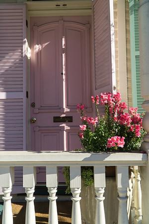 Door, porch and flowers.