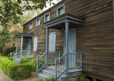 On State Street, this old log cabin from 1815. What's impressive about Savannah is the remarkable preservation of its historic core—a huge swatch of old homes and buildings.