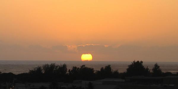 The sun goes down on Honolulu Harbor