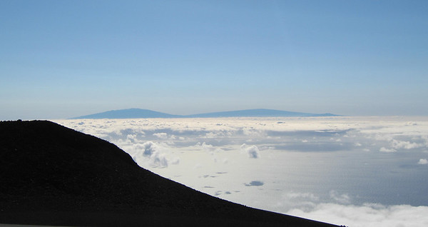 At 10,032 feet we are well above the clouds.  The island in the distance is Hawaii the Big Island.