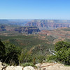 Looking into the Grand Canyon from the North Rim.  The Colorado River is beyond the buttes in the distance and the South Rim is visible as only a gray line in the far distance.