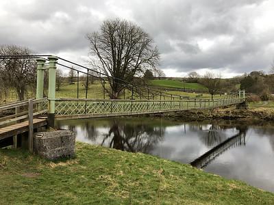 Suspension bridge across the river Wharfe near Hebden village