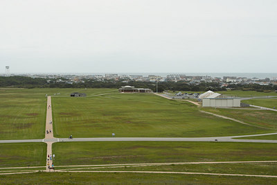 A view from the top of the dune shows all of the Wright Brothers National Memorial.  The closest buildings (far right) commemorate the 100th anniversary of their 1st flight.