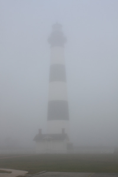 Bodie Island lighthouse in the eeriness of a fog bank, Outer Banks, North Carolina
