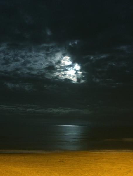 A full moon casts a moonlight across the Atlantic ocean, Kill Devil Hills, North Carolina