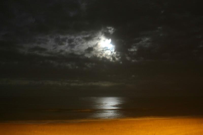 Full moon trying to peek through clouds, Kill Devil Hills, North Carolina