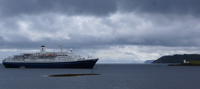 Marco Polo anchored off Stornoway Harbour with Arnish Point lighthouse and the east coast of Lewis beyond