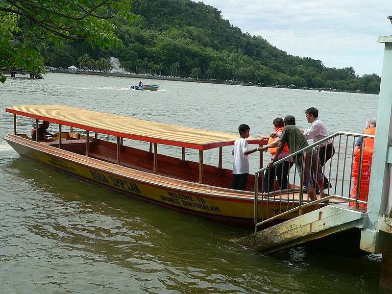 """Part of our tour group getting on a boat for the """"sail by"""" visit to Kampung Ayer."""