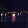 Night view across one of the swimming pools at Le Tamassa Resort.