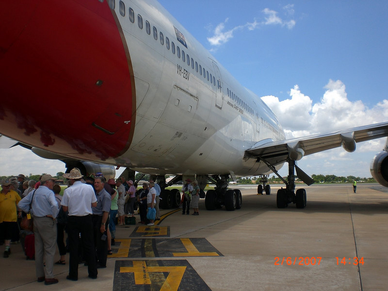 Waiting for the group shot to be taken at Phnom Penh International Airport.  Most people took advantage of the shade afforded by our Qantas aircraft.