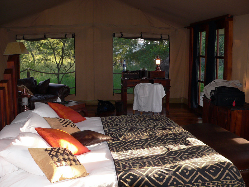 """Looking across the bed in Tent 12 out the tent's """"windows""""."""