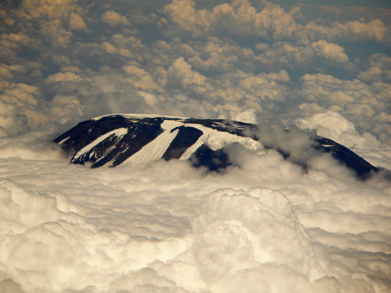 Top of Mount Kilimanjaro, Tanzania.  Taken from inside our Qantas Boeing 767 charter jet.
