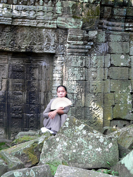 Inside Ta Prohm Temple - I love this shot - the young lady wasn't posing for this picture - which makes its capture even more special to me.