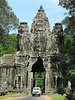 The South Gate of Angkor Tomh, with one of its four faces pointing in each of the cardinal directions.