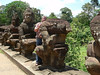 Part of the impressive avenue of Asuras (demons) lining the bridge across the moat at the South Gate of Angkor Thom.
