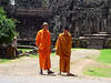 Two Buddist Monks departing the Bayon Temple.