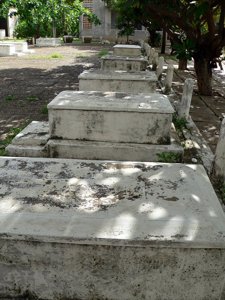 The graves of some of the last Cambodians slaughtered under the regime of the Khymer Rouge at Tuol Sleng in Phnom Penh, which forms part of the Museum of Genocidal Crimes.   Tuol Sleng is also more infamously known as S21.  S21 was a school before it became a place of inhumane torture and death.