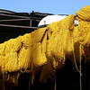 The Souk Marrakech.   Yellow dyed yarn hanging out to dry.