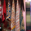 Bright colourful scarves and runners for sale in the Souk at Marrakech.