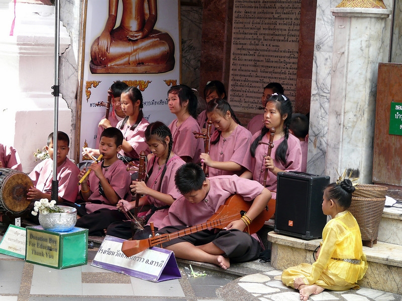 Young musicians at Wat Phra That Doi Suthep temple complex outside Chiang Mai.  This temple is one of Thailand's most famous pilgrimage sites.  It has an elevation of 3,520 feet (1,073 m) on the slopes of Mount Suthep, one of Thailand's highest peaks (5,528 feet [1,685 m]), just outside the city.