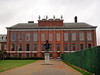 Kensington Palace with statue of William III in front.