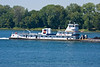 Tug and river barge headed up the Ohio River at Owensboro, Ky.