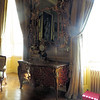 A not-very-good picture of the ornate desk in the Green Drawing Room.  The mirror and the clock (which you can just barely make out) is mounted on a black bull, are 18th-century.