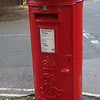 In the U. S. we don't have many mailboxes on the street anymore, but in England you still see the distinctive red pillar boxes.  Note the ER cypher at the bottom.  That does not stand for Queen Elizabeth, but for Edward VII, who reigned from 1901 to 1910.  So this pillar box has been doing its duty on this street corner for more than 100 years.