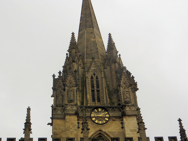 The distinctive spire of St. Mary the Virgin.  This church stands next to the Radcliffe Camera.  It can be considered the original hub of the University, for the first university meetings and ceremonies were held here, and the administrative archives were stored here.  The trials of the Oxford Martyrs were held in this church.  The steeple dates from the early 14th century and features a BUNCH of crocketed pinnacles (remember those?) ornamented with statues of saints.