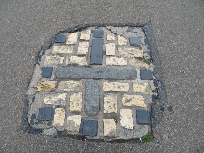 This simple cobblestone cross, set in the pavement of Broad Street near the Martyrs' Memorial, marks the exact spot where they were burned.