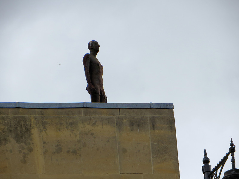 No, it's a statue by Antony Gormley of a 7 foot high naked man.
