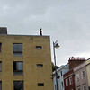 Walking along Broad Street, I could see this figure on top of one of the buildings.  Somebody about to jump?