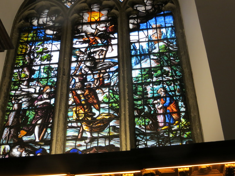 I think this window may be Elijah being taken up into heaven.