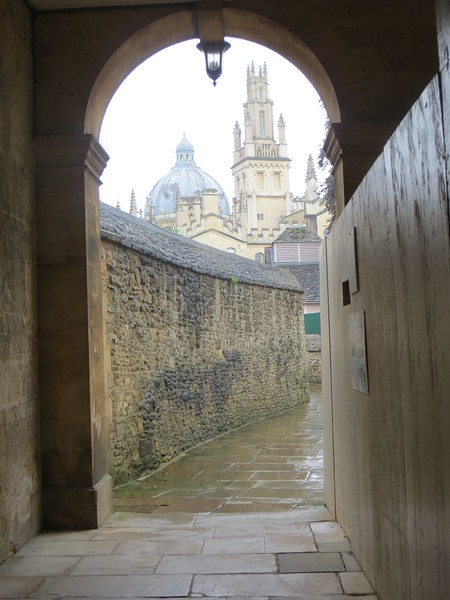 Oxford has a way of tempting you to try artistic photography!  This view appeared as we were leaving The Queen's College.  You can see the dome of the Radcliffe Camera in the distance, and one of the towers of All Souls College in front of it.