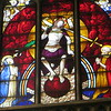 The centerpiece of the Last Judgment window, showing Christ, sitting on a rainbow and using the world as his footstool; he is flanked by Mary and John the Baptist.